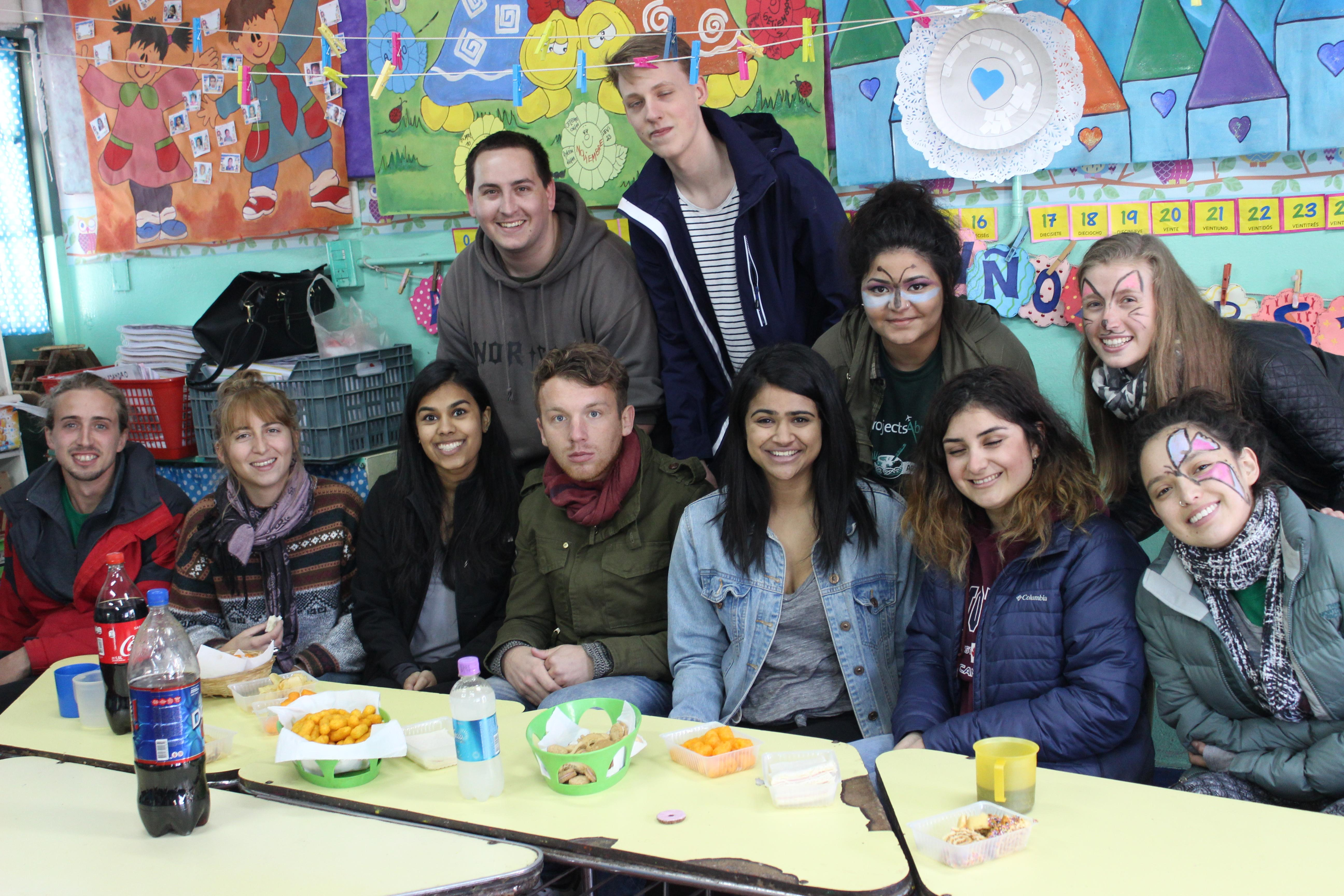 A group of volunteers work with children in Argentina on our placement for high school students